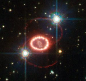 Particle detectors were able to record a few of the enormous number of neutrinos emitted by supernova SN1987A, here shown in a Hubble Space Telescope photo.